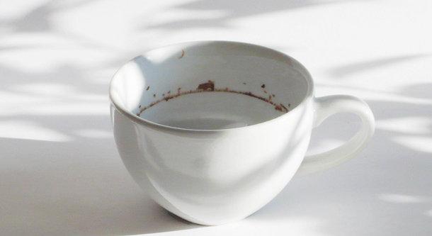 Koffiekopje met een landschap print